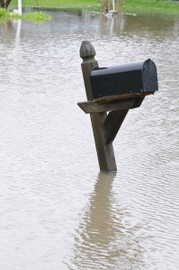 Curbside mailbox in floodwater